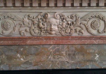 marble decoration on a fireplace